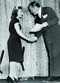 Barbara McLean receiving her Academy Award in 1945 from Bob Hope for her work on Wilson (1944)