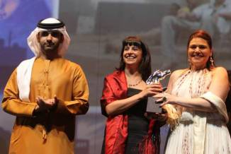 Director Nadine Khan (centre) and producer Dina Farouk receive the Special Jury Prize for 'Chaos, Disorder' (2012) at the 9th Dubai International Film Festival